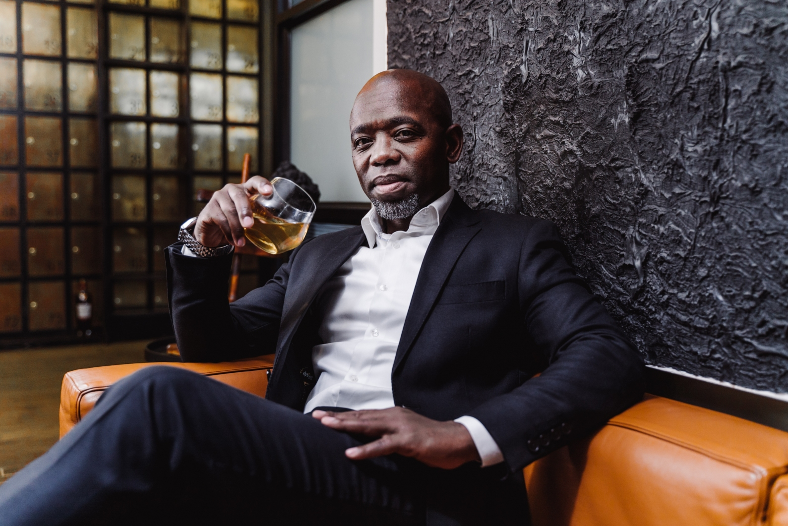 gallery/thami banda holding a glass of the macallan whisky